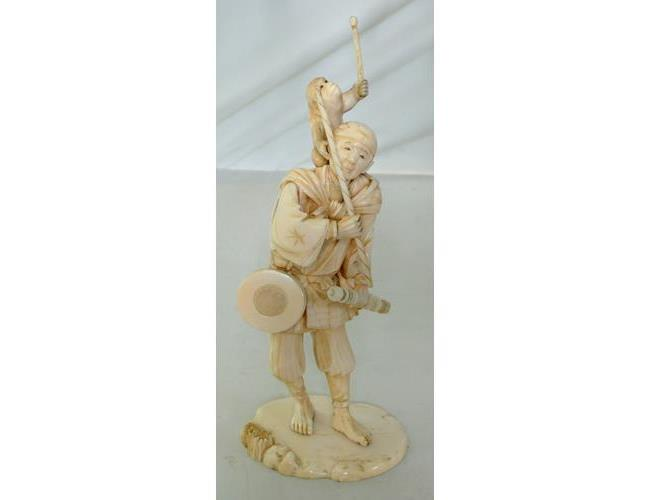 A Fine Antique Signed Oriental Carved Ivory  Sculpture of a Musician