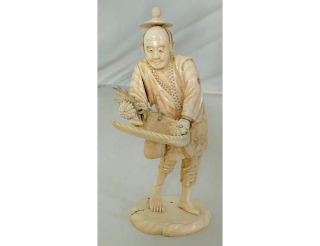 A Fine Antique Signed Oriental Carved Ivory  Sculpture of a Flower Seller with Basket.  19thc.
