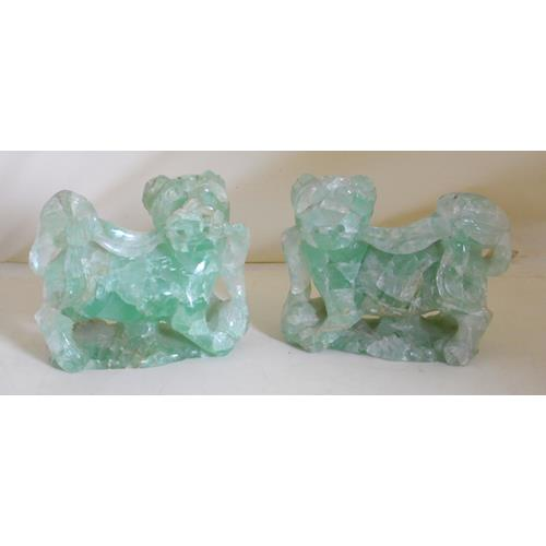 A Pair of Chinese Carved Green Quartz  Sculptures of Lions. Circa 1900.