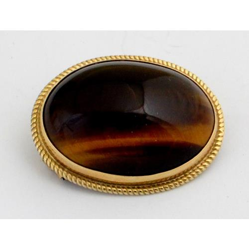 9ct Yellow Gold Cabouchon Tigers Eye Brooch.  28 x 20 mm. Boxed.