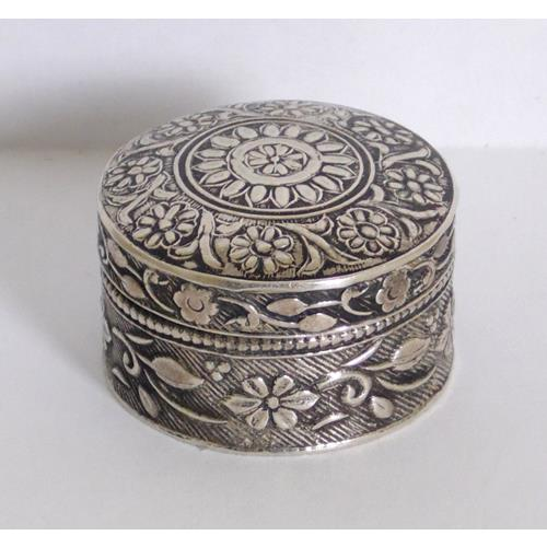 Sterling Silver Pill Box and Push on Cover  with Floral Decoration.