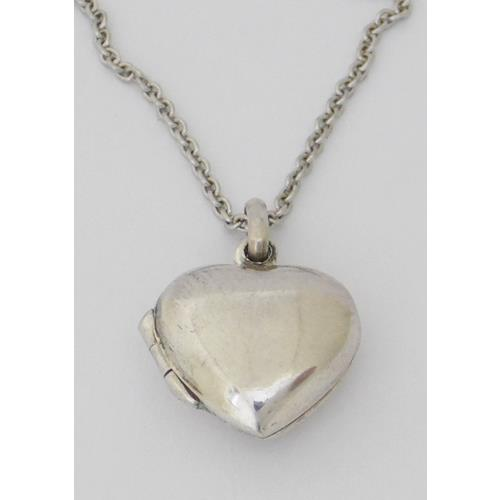 Sterling Silver Heart Locket on 16 inch  Silver Chain. Marked .925. Boxed