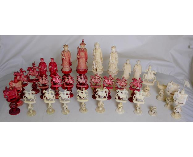A Large Chinese Carved and Stained Ivory  Puzzle Ball Figural Chess Set. 19th century.