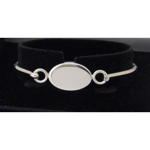 Sterling Silver Bangle. Marked .925,. Fitted  presentation case.
