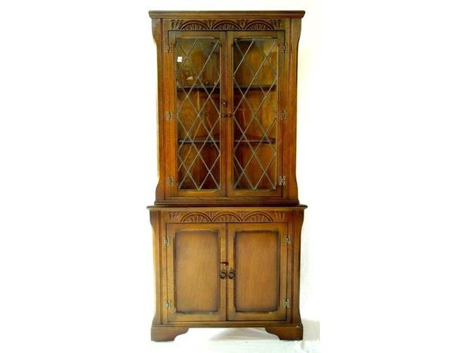 Old Charm Style Carved Oak Lead Glazed Corner  Cabinet. 20thc.