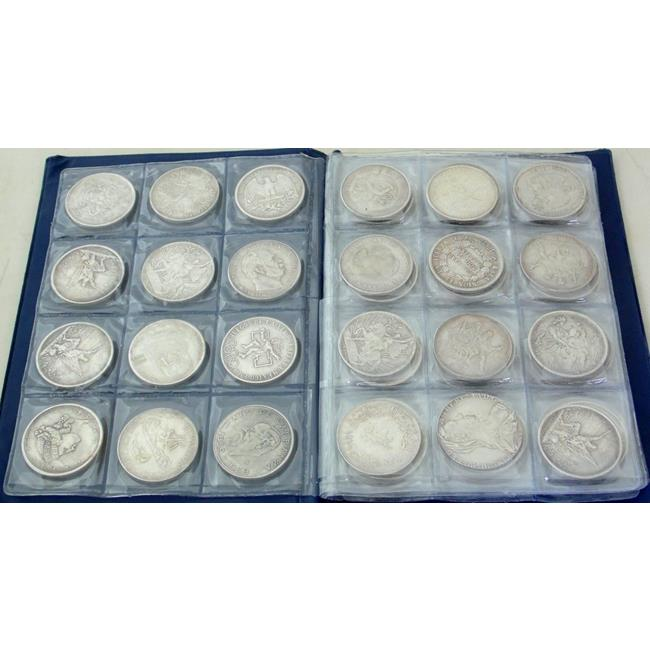 Collection of Coinage in Blue Folder.