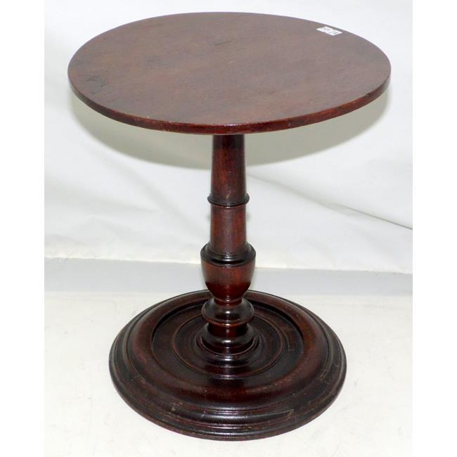 A 18th Century Turned Mahogany Candlestand.
