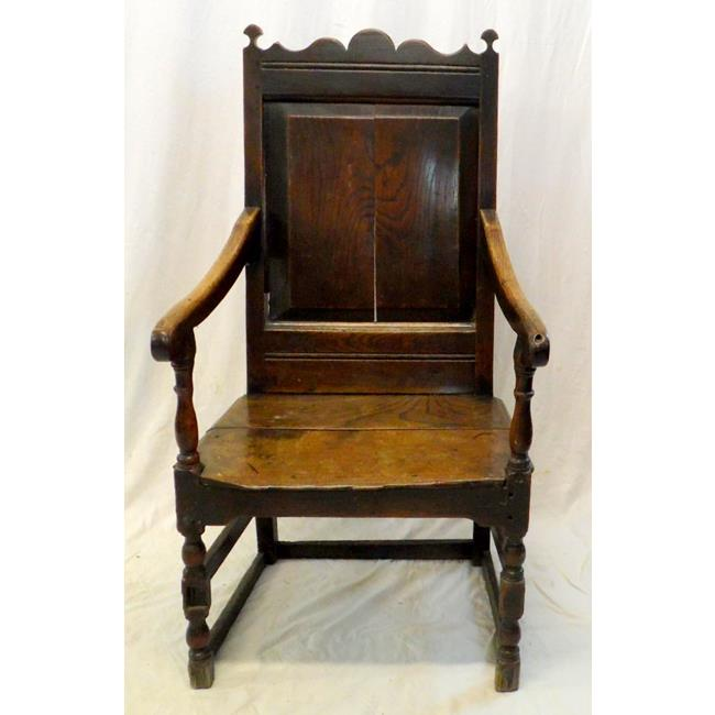 A 17th Century Oak Wainscoat Armchair.