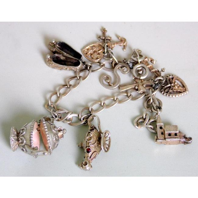 Sterling Silver Charm Bracelet with 7 Charms.