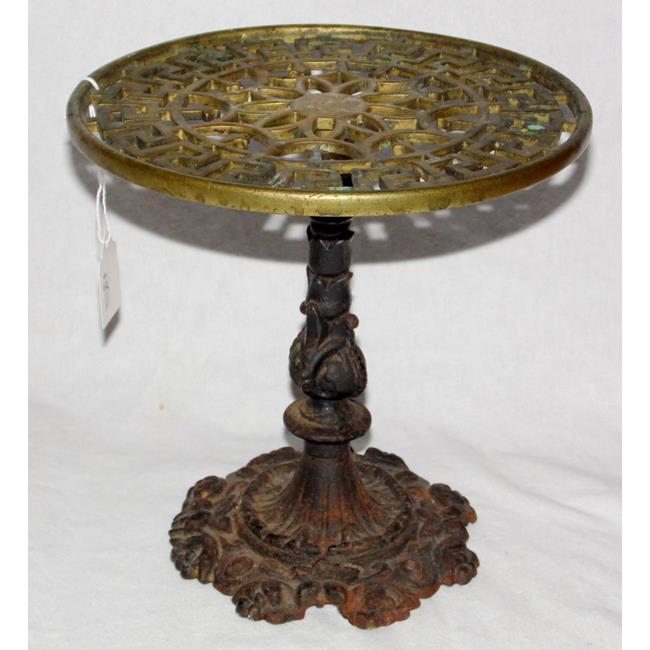 Antique Cast Brass and Cast Iron Circular Trivet .